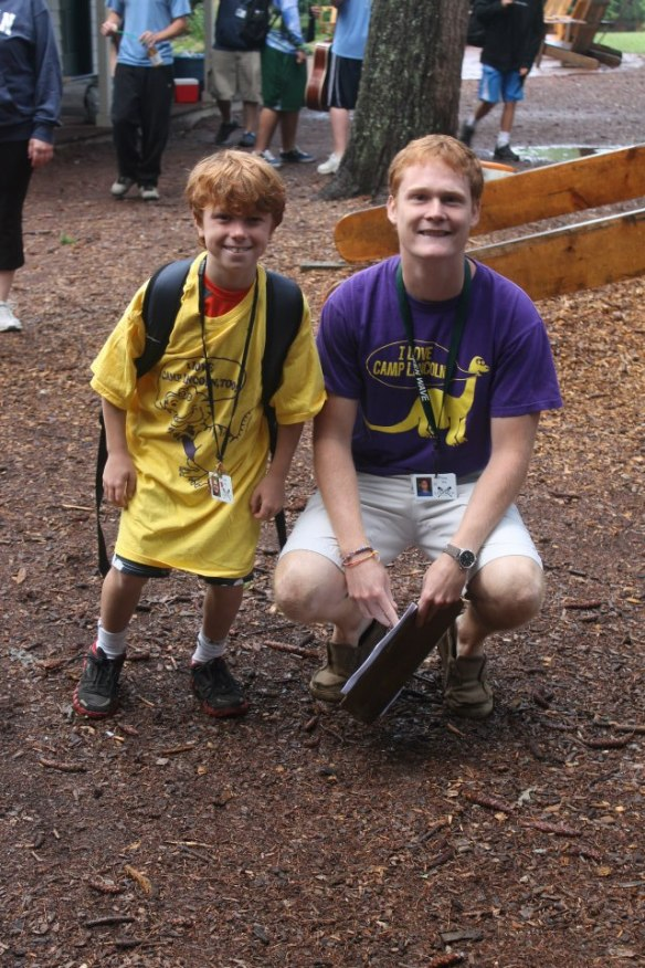 Jake Roy with a camper at YMCA Camp Lincoln